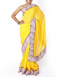 Yellow Chiffon Sari with Border. A chiffon base sari featuring gotta patti trim on the border. Team with simple jewellery and heels for an elegant look. A pink raw silk blouse piece is available with the saree & the blouse in the image is used only for photography.  Available on www.designerkapde.com