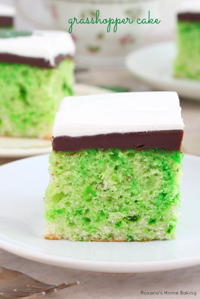 Pretty green and white swirled grasshopper cake topped with a rich chocolate ganache and airy whipped cream. Recipe from Roxanashomebaking.com #StPatricksDay