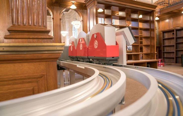 """new york public library - As part of the New York Public Library's multi-million dollar renovation, the facility is introducing a """"book train"""" to bring mat..."""