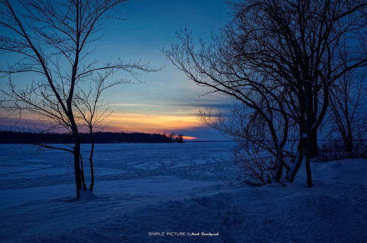 The Darkness Is Coming - Incoming darkness can be beautifully deceiving - wintry sunset on the frozen Lake of Two Mountains/Lac des Deux Montagnes in Quebec, Canada.