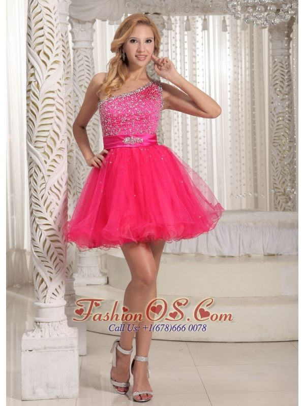 One Shoulder Beaded Decorate Bust Sweet Prom / Cocktail Dress With Hot Pink In Texas  http://www.fashionos.com  http://www.facebook.com/quinceaneradress.fashionos.us   An absolutely perfect gown when looking your best is a must. Heavy sequin throughout the bust area give a hint of the beauty of your wonderful curves, this gown features a one-shoulder bodice and a-line skirt. The one shoulder dress is decorated with intricate beaded bodice and a waist band.