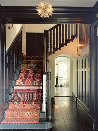 Friendly stairs with mismatched carpet.  Love it.