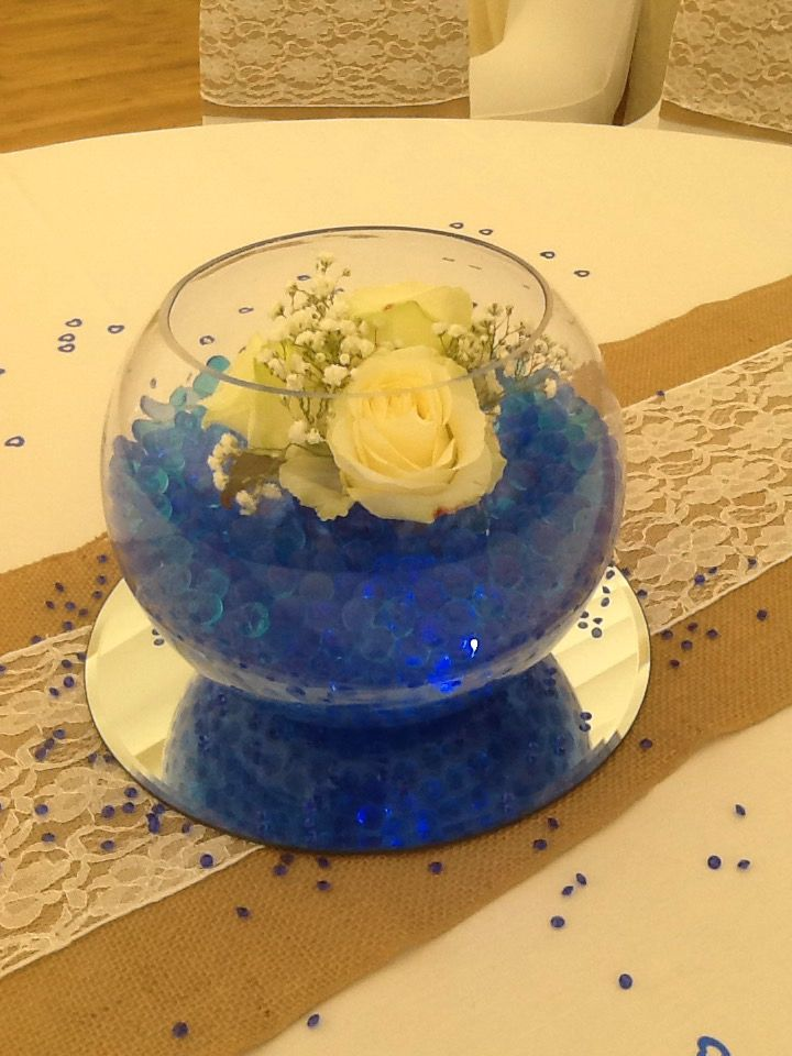 Goldfish bowl with blue deco beads and Avalanche roses and gyp to finish