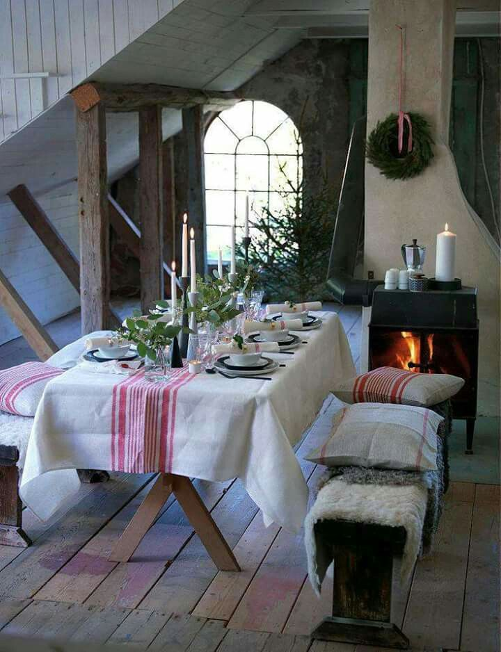 Simple red and white grainsack fabric set the tone for this Scandinavian style farmhouse Christmas tablescape.