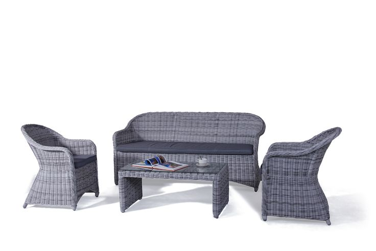 Wicker Four piece wicker outdoor setting with base cushions, includes glass top coffee table