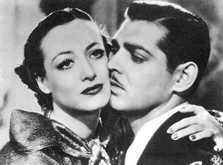 Clark Gable and Joan Crawford. Poor Clark looks a little overwhelmed in this shot.