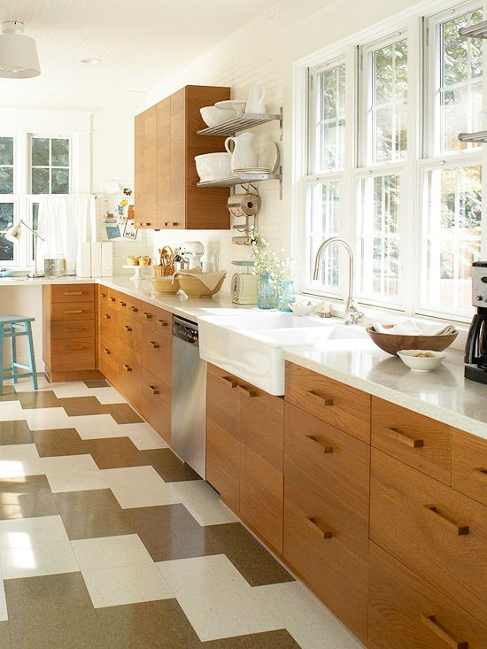 What a pretty kitchen! Love the bold floors, cabinets, farm sink and the faucet. The windows are what makes this kitchen special.