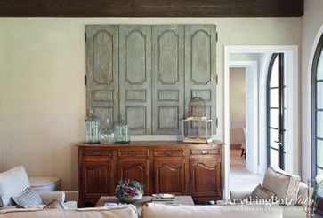 mediterranean family room The Great Cover up   7 Ways to Disguise Your TV - from Anything But Plain