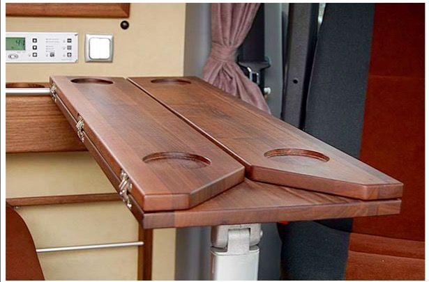 Clever folding table in Mercedes Sprinter camper van from CS Independent.