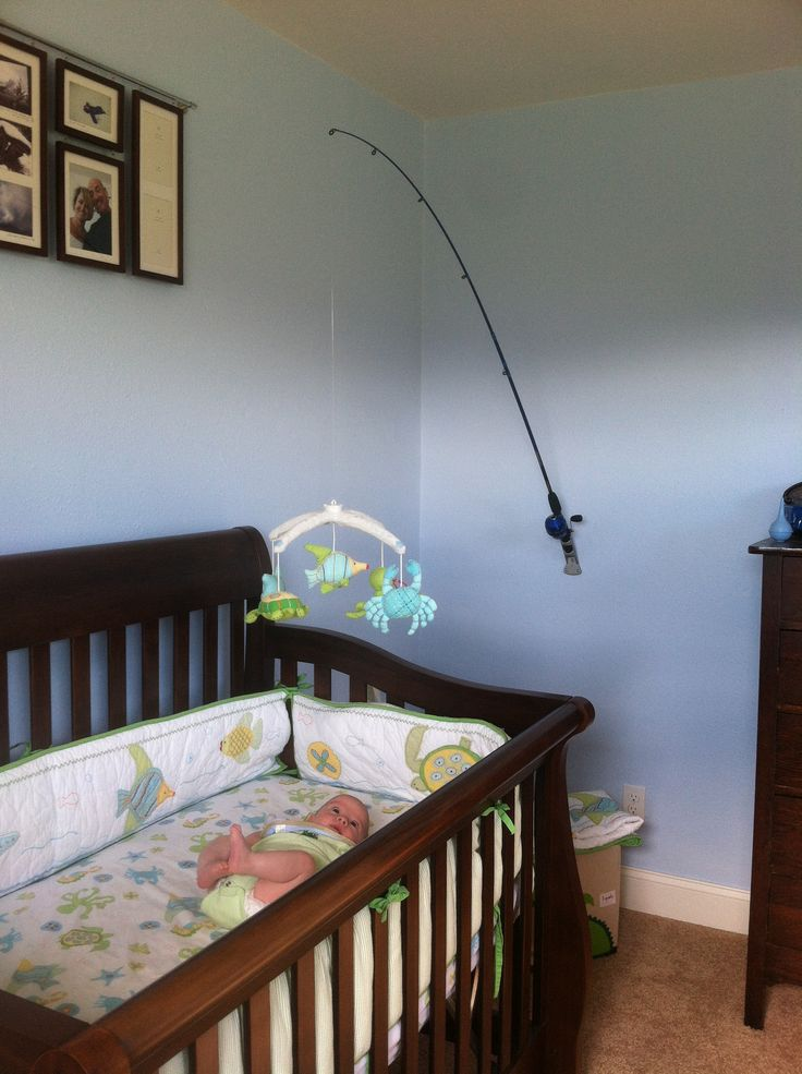 Use a fishing pole and flag pole mount to hang the mobile for Baby fishing pole
