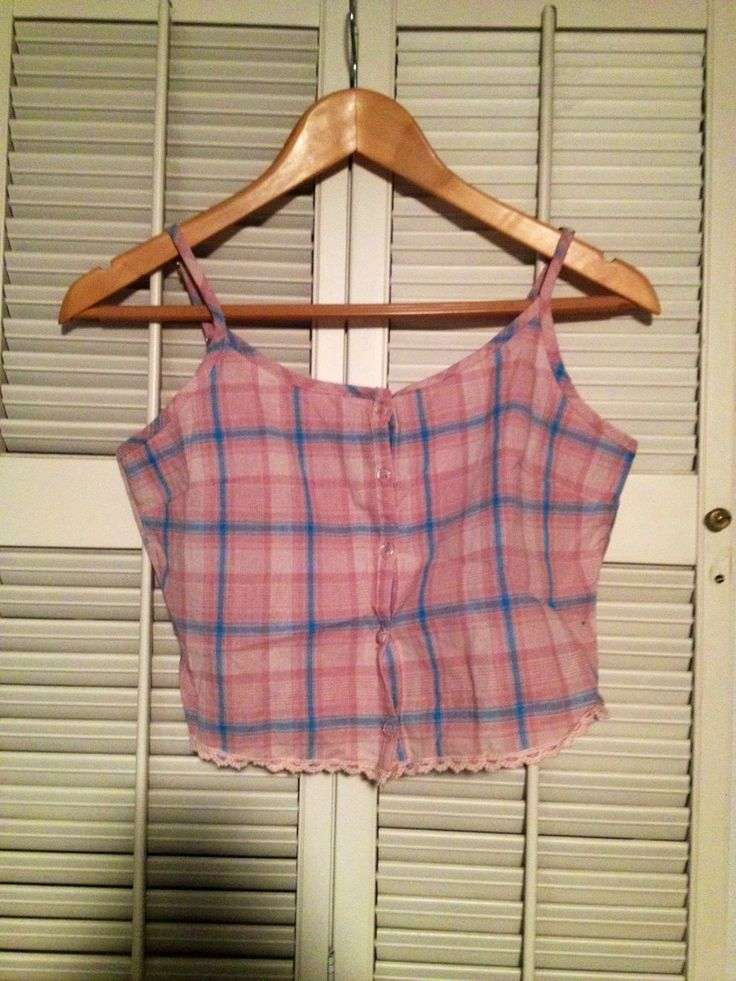 Crop top from Wet Seal, size small. Cropped tank top in pink/purple/blue plaid and lace detail at the bottom