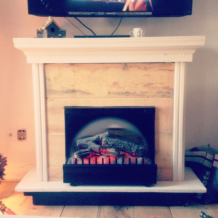 Faux fireplace with scrap wood from leftover flooring