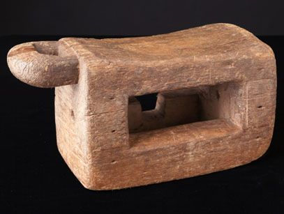 "www.africaandbeyond.com. Stool from the Baule People of Ivory Coast.  Among the Baule, stools are a symbol of leadership. The surface of the wood indicates extensive use and age. The stool is carved from a single piece of wood including the carrying handle.  8""H x 17""W x 7""D."