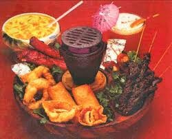 "Pu Pu Platter - I still think they're yummy!  For extra-special family dinners Mom and Dad'd take us to Jade East where Mason and I would split one for dinner.  WOW, we were SO ""grown up""!  The little tinfoil-wrapped chicken packets were the best!"