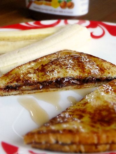 Banana nutella stuffed french toast. YUM! Notes: 2 slices whole wheat bread, 1T nutella, 1/2 banana, 1 egg, 1T skim milk, little bit of vanilla and a little bit of cinnamon. Delicious!