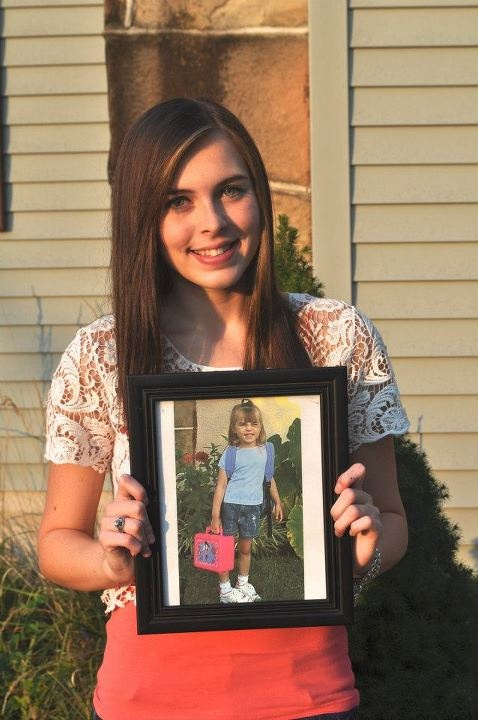 My first day of Senior Year holding a picture of my first day of Kindergarten