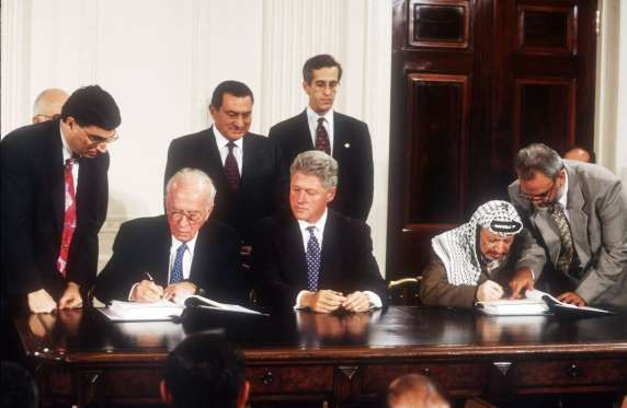 1995 -  SEPT. 28, 1995: ISRAEL-PALESTINIAN PEACE ACCORD IS SIGNED Israeli Prime Minister Yitzhak Rabin and PLO Chairman Yasser Arafat signed the historic Interim Agreement on the West Bank and the Gaza Strip, known as Oslo II Accord, at the White House in Washington, D.C., U.S. It was witnessed by U.S. President Bill Clinton and other dignitaries from Russia, Egypt, Jordan, Norway and the European Union.