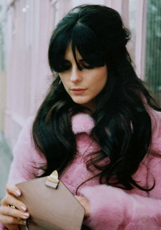 Long 60s style brown hair with long fringe, blunt cut lash length, tapered slightly to cheekbone length.