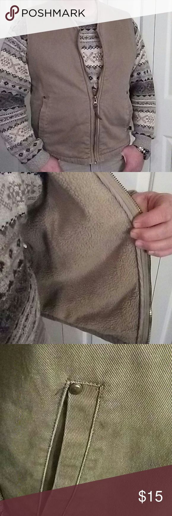 Woolrich Sherpa Lined Vest Heavy duty tan denim fabric with matching sherpa lining. Looks great with a sweater as shown.This vest gives added warmth when a coat is too much. Looks great too. Nice condition.Versatile. Woolrich Jackets & Coats Vests