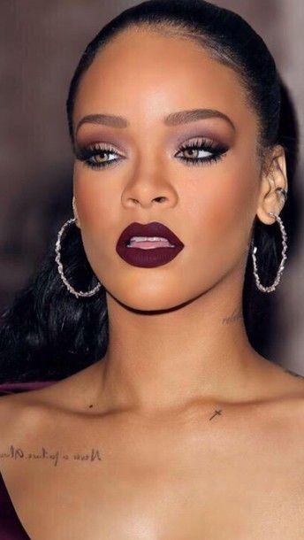 $5 - $32 Make-up tips for bold look inspired by Rihanna: dark burgundy lips, purple tinted eyeshadow and matte face.