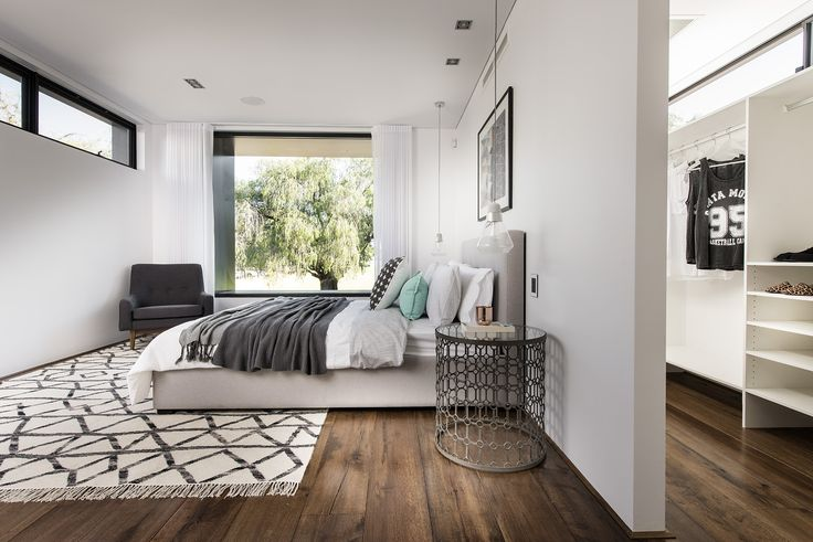 Open walk-in wardrobe makes the most of natural light at The Tribeca display home by Webb & Brown-Neaves.