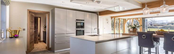 A light-filled Flint and Kaolin bulthaup b3 kitchen in an oak-framed countryside property, designed and installed by hobsons|choice.