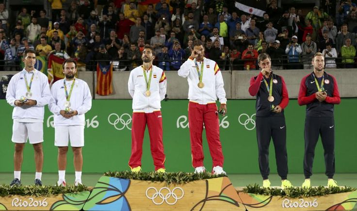 Men's Doubles Victory Ceremony - Olympic Tennis Centre - Rio de Janeiro, Brazil - 12/08/2016. Gold medalists Rafael Nadal (ESP) of Spain and Marc Lopez (ESP) of Spain, silver medalists Florin Mergea (ROU) of Romania and Horia Tecau (ROU) of Romania, and bronze medalists Steve Johnson (USA) of USA and Jack Sock (USA) of USA pose with their medals