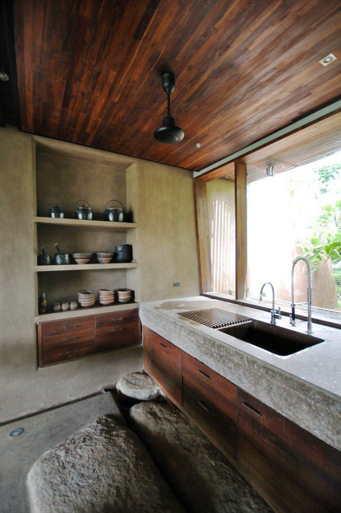 Stone And Wood Make A Dark Masculine Interior: Rough Hewn Stone Slab Sink With Restaurant Dish Washer
