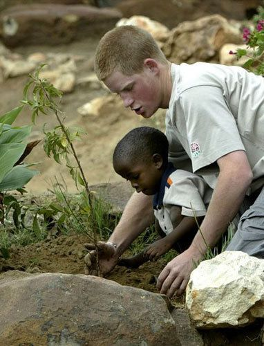 In his mother's footsteps Prince Harry and an orphan boy plant a peach tree at the Mants'ase Children's Home on March 3, 2004, in Mohale's Hoek, Lesotho. While spending time in Lesotho during his gap year after finishing at Eton, the prince made a documentary about children at the home, which helps children orphaned by and suffering from AIDS.