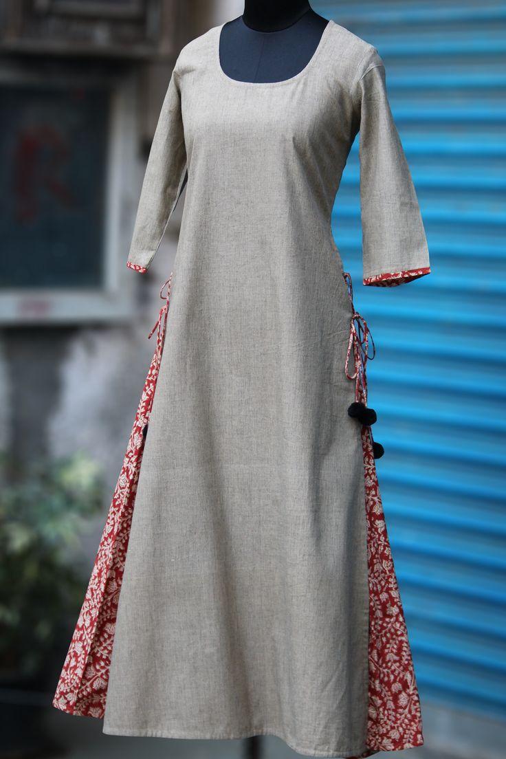 a long kurtain layers with mangalgirifabric & handblock prints! the layered kurta has tie-ups and woolen fumdas to add to the pop! 100% cotton, handbloc