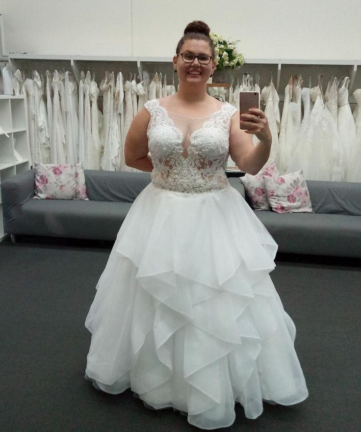 This plus size wedding dress has a beaded bodice with ornate detail.  We can make custom #plussizeweddingdresses like this for you with ease and with any design changes you need - like adding sleeves. We are American dress designers who specialize in totally custom wedding dresses made for brides of all sizes. We can even make pretty close #replicadresses that look like an original couture design but cost much less.  Get pricing on any dress you love when you visit www.dariuscordell.com/