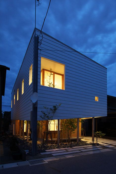 OH House by Takeru Shoji Architects.  A white timber roof masks the upper storey of this Japanese house by Takeru Shoji Architects, but is raised on wooden stilts to reveal the pale timber facade of the lower level. http://www.dezeen.com/2014/11/10/oh-house-takeru-shoji-architects-timber-roof-japan/