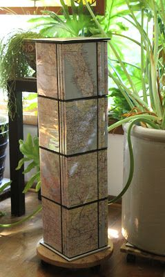 plant stand made from map covered dvd cases
