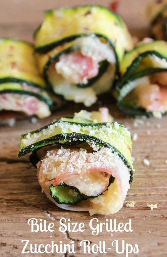 Bite Size Grilled Zucchini Roll-Ups, an easy and tasty appetizer. Grilled slices of zucchini filled with ham or prosciutto and cheese, then rolled and baked. A warm and delicious bite size antipasto or side dish.