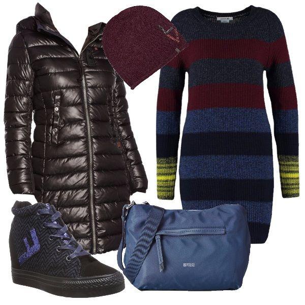 Il vestito in maglia di pura lana a righe nei toni del blu, nero, rosso e giallo si completa con il piumino lungo nero sagomato con cappuccio in materiale e imbottitura riciclata. Ai piedi sneakers con zeppa interna nere con inserti in lustrini bluette e come borsa tracolla in materiale impermeabile blu color jeans. Per finire cappellino bordeaux in maglia di lana con decori di lustrini.