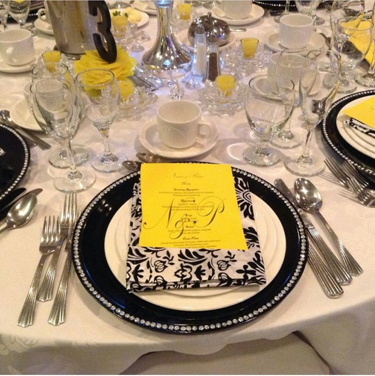 Beautiful rhinestone black charger plate and pocket fold damask napkin with menu inside.