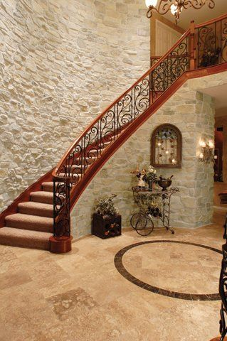 In basement- Beautiful Stone Veneer Accented Staircase with tile floor                                                                                                                                                                                 Mehr