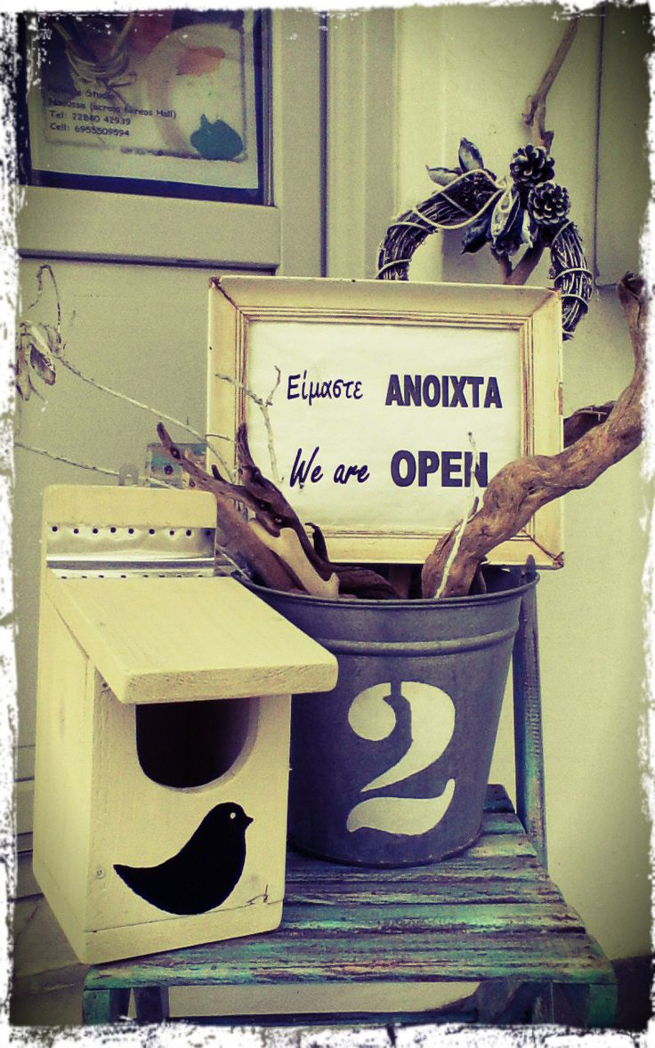 Unique handmade items in the shop - birdhouse, painted chair, wreath, personalized metal bucket.