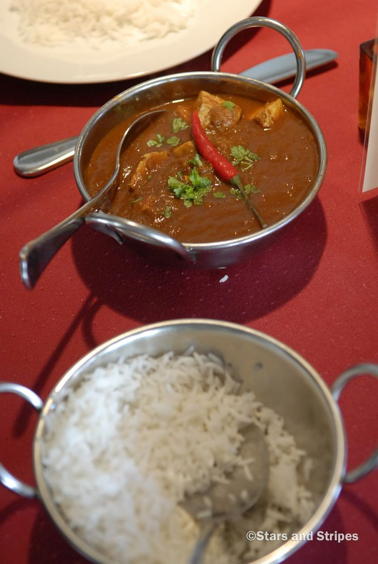 The chicken chili masala, topped with a red chili pepper, is one of the spiciest dishes at the Maharaja Indian Restaurant in Ramstein-Miesenbach. (Jennifer Svan/Stars and Stripes) #Germany #IndianFood