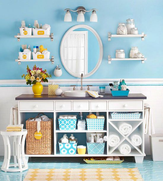 Take off the doors of the vanity and use decorative bins and baskets to organize items inside the open cabinets.