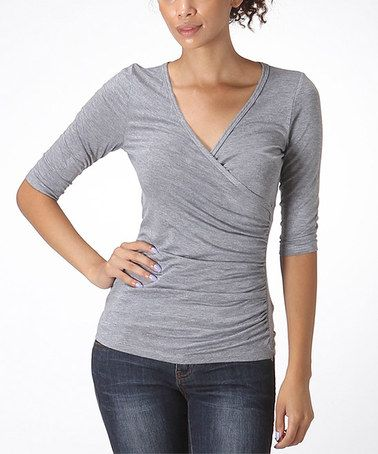 Ruching is flattering and wrap style is good for nursing. Add a flowy cardigan for Fall.