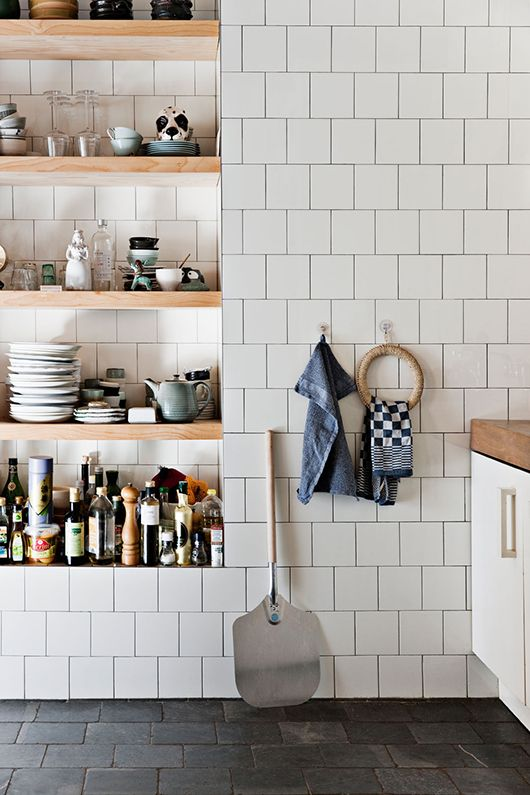 wood shelving + white tile