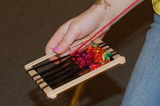 popscicle sticks and yarn weaving