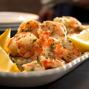 Marinating precooked shrimp in garlic- and lemon-infused oil is a simple yet elegant appetizer.