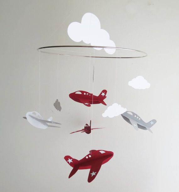 Sweet airplane mobile with fluffy clouds will brighten up a childs room. This mobile can be created in any color. Made from heavy card-stock