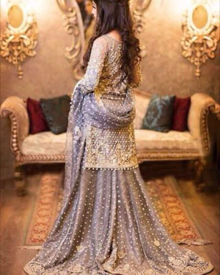 """#imbasat looked spectacular at their wedding reception ! Wearing a long fitted sleeve purple shirt with gold embellished Lehnga !…"""