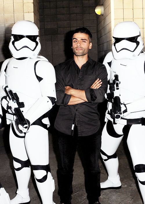 Oscar Isaac with Stormtroopers backstage at the Lucasfilm panel during Comic-Con International 2015 at the San Diego Convention Center on July 10, 2015 in San Diego, California.