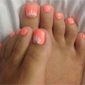 Coral Toe Nail with White Flowers on.