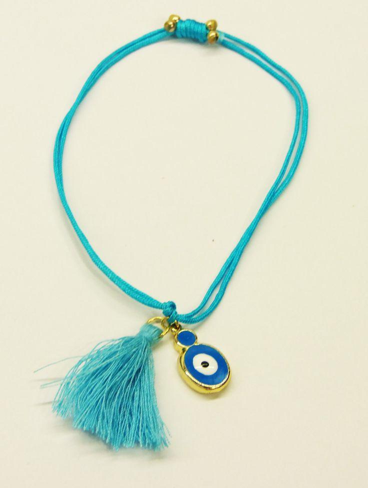 Handmade bracelet/blue leather/blue tassel/base metal oval charm/gold plated/24 carats/blue enamel/eye by CrownedCharm on Etsy