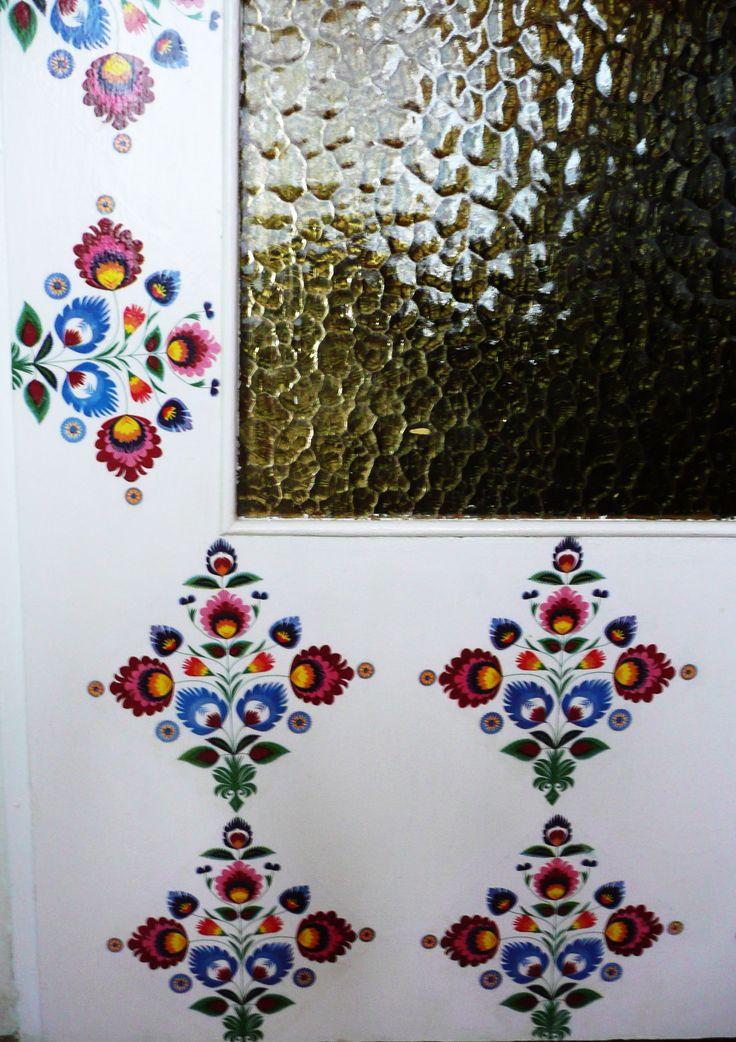 Folk doors - close-up. Decoupage technique.  Pattern: Polish paper cutting (Wycinanki) folk art. Łowicz region.